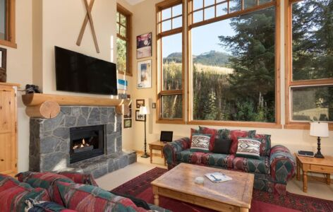 Cozy living room with a gas fireplace and wonderful mountain views